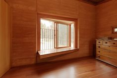 Rammed earth house in Victoria, by Steffen Welsch architects. Bay window with views.