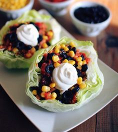Lettuce Wrap Tacos: Corn, Black beans, black olives, lettuce slices, sour cream