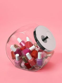 """""""Little bottles of nail polish can take over the bathroom. So I stash them in an old-fashioned glass candy jar."""" — Liz Caan, interior designer, Newton, Mass."""