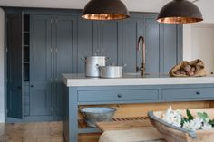 A beautiful chapel kitchen in the Cotswold's, fantastic high wall cabinets to make use of this unusual space. A really unique and bespoke kitchen.