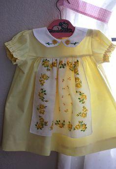 Precious little dress integrating vintage hankies into the design.