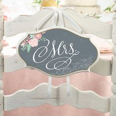 "These ultra-pretty wedding chair signs are the perfect addition to your rustic, vintage, or woodland themed event. Each sign features a beautiful font displaying a ""Mr."" and a ""Mrs."" design complete with a complimenting art pattern."