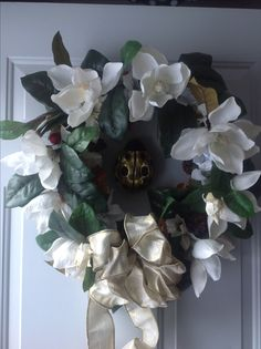 Upcycled magnolia door wreath. All the elements are from thrift stores or our craft closet.