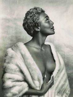 "With the perfect hourglass figure, backless dresses & silver tinted hair, jazz singer Joyce Bryant became known as ""The Bronze Bombshell""  AKA The Black Marilyn Monroe. She would become the first dark-skinned African-American woman celebrated by the mass media as a 'sex-symbol'. She made her way to the stage in 1940. It was there she gained national and international acclaim for her earthy, sultry tone and figure flattering costumes."