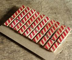 candy striped clothes pins. $5.00, via Etsy.