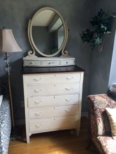 Finished antique chest of drawers and floating vanity mirror - hand painted in Annie Sloan Old White and distressed with clear wax.  Top stripped and restored in Jacobean stain.