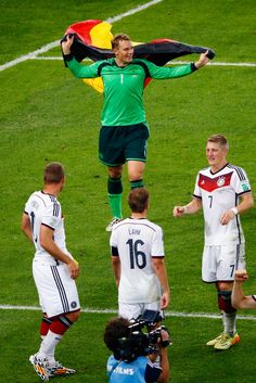 Manuel Neuer celebrates with a german flag after defeating Argentina 1-0 in extra time in the 2014 FIFA World Cup Brazil Final match between Germany and Argentina at Maracana on July 13, 2014 in Rio de Janeiro, Brazil.