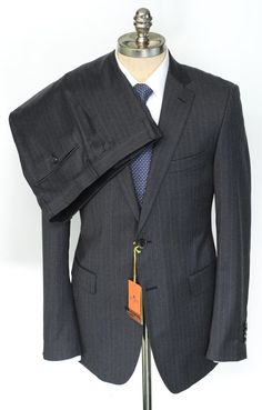 There's most assuredly a bright paisley lining under this demure charcoal #gray #pinstripe #suit by #Etro.  |  Want your own? http://www.frieschskys.com/suits  |  #frieschskys #mensfashion #fashion #mensstyle #style #moda #menswear #dapper #stylish #MadeInItaly #Italy #couture #highfashion #designer #shopping