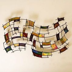 Kirby Abstract Wall Art by Southern Enterprises. Save 42 Off!. $90.99. Spice up any room. Crafted from metal for durability. Features a black grid with hand painted squares. Dimensions: 42 W x 2.75 D x 27.25 H. Comes fully assembled. GA1205 Features: -Exquisite abstract art decor.-Unique distorted grid.-Effortlessly spice up your home.-Perfect way to quickly change the feel of any room!. Color/Finish: -Bright color schemes. Collection: -Will sure to match all home collection.