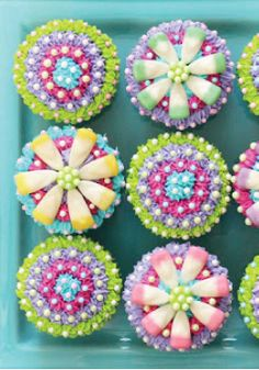 Skip the usual flowers this Mother's Day and give mom these Flower Cupcakes instead. A bright and colorful edible gift!