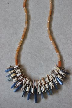 This is one of my most intricately designed statement necklaces, using stone and shell slices. There are shades of vivid blue, amber brown