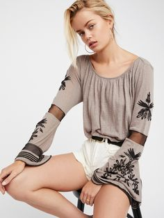 Bonjour Bell Sleeve Tee   Inspired by decades past, this top is featured in a lightweight and semi-sheer linen blend.    * Extreme bell sleeve with mesh and embroidery detailing   * Banded waist   * Wide neckline