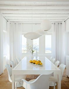 Bright White Building Design Looking so Modern and Awesome: Neat Dinning Room With White Chairs Facing Fruits That Are Under By Pendant Lamp At Mykonos Kanalia Hill House ~ HKSTANDARD Architecture Inspiration Dining Room Design, Dining Area, Dining Table, White Beach Houses, Interior Decorating, Interior Design, Decorating Ideas, White Rooms, Dining Furniture