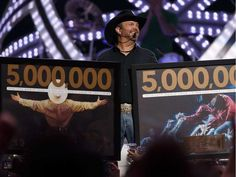 Garth Brooks celebrates the 5 millionth Garth Brooks ticket sold during his 2017 tour on stage at Rogers Place in Edmonton on Friday, February 24, 2017. A Garth Brooks banner was revealed in the rafters during the concert.