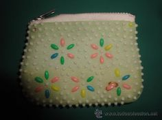 OK, this is what we did with these purses.  We would tear a beads off and swallow it when we were bored or daring each other.  Amiright??  Anyone else?  Bueller??