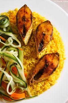 Fried Hilsa and Lentil rice (Khichuri). Recipe: http://myselfnusrat.wordpress.com/2013/03/17/fish-fry-2/