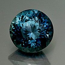 """Montana Sapphire """"Portuguese"""" Cut Round Weight: 1.07 cts. Measurements: 5.9mm diam., 4.1mm depth ~ Color is deep blue with turquoise to teal flashes. Deeply colored but brilliant and flashy too. (Cut by Andrew Gulij)"""