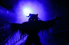 <span>A participant dressed as the Krampus creature scares onlookers during the Krampus gathering in Goricane, Slovenia, on November 21, 2015.</span>