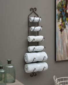 "Rustic Iron Wall Rack This unique metal wall rack is extremely versatile. Perfect in the kitchen for organizing utensils, great in the bar to hold a collection of wine bottles and perfect in the bathroom to display hand and bath towels. Get creative outdoors too - use it to hold pool towels or BBQ tools and aprons! The uses for this versatile piece are endless! Also available in White or Fleur de Lis. Dimensions: 41""h x 7.25""w x 7"" *Please allow 3-5 days for processing before the item ships."