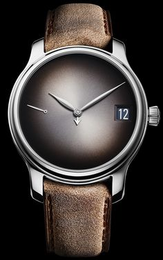 """H. Moser & Cie. Endeavour Perpetual Calendar Concept 'Minimalist' LE Watch -on aBlogtoWatch.com """"Is the H. Moser & Cie. Endeavour Perpetual Calendar Concept watch's beautifully simple design enough to merit the sacrifice of easy readability? That is something that is up to each individual who views it to judge. Only ten people, however, will have to think extra hard about whether it is worth their money, as only ten pieces will be produced in this ultra minimalist, white gold limited…"""