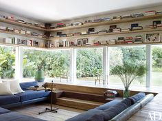 Shelves built above the cinema room's windows outline the perimeter of a sunken seating area.