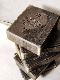 Stack of Gunpowder soap bars. Perfect combination of smooth and gritty. Coffee, tea tree oil, green tea, green clay soap. Made in Canada, Alberta.