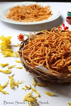 Besan Sev Recipe - a mild spiced, deep fried savory and snack made during Diwali! #diwali #sev.