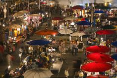 Chiang Mai's Sunday Walking Street market, where shoppers' eyes twinkle as brightly as the lanterns. #Thailand.