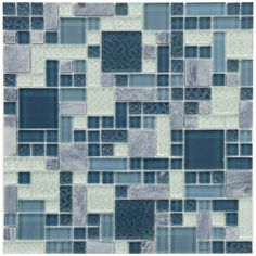 This is a blue and white toned mosaic that features a fascinating mix of glass and stone textures. A combination of smooth and textured glass and tumbled natural stone mix beautifully to create a multi-dimensional effect.