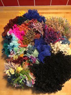 cutting up thrums—weaving & spinning waste—to make a rya rug