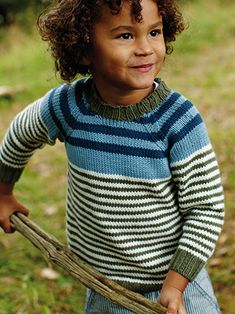 DEACON STRIPE from Little Rowan Explorers by Martin Storey.This fashionable collection of kidswear was designed by Martin Storey and is suitable for 3-8 year olds. It features simple knits alongside graphic colourwork, offering something for knitters of all skill levels | English Yarns