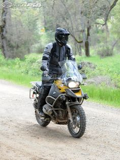 BMW's best-selling R1200GS and R1200GS Adventure get an updated engine for 2010. Read our motorcyle review in the 2010 BMW R1200GS Adventure First Ride