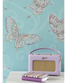 This striking wallpaper has a classic scroll design with beautiful butterflies set on a matte teal background with turquoise, purple and green accents and gold highlights.The design is printed on to luxury heavyweight paper to ensure durability and a quality finish. Also available in a brilliant pink.