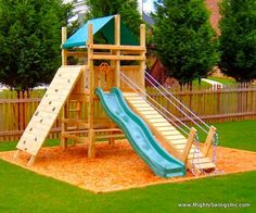 A slide, rock wall and draw bridge - just needs a fireman's pole and swings on the side, oh and  a sand pit at the bottom