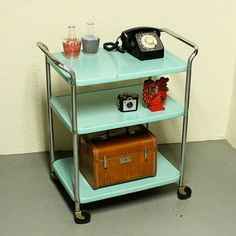 frickin sweet colored kitchen cart - my grandmother had of these in red that sat in her kitchen.
