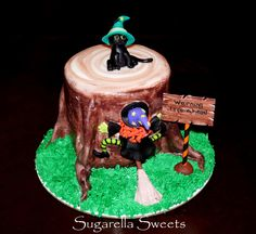 Halloween warning tree ahead witch cake. With cat cake topper. Super cute, perfect for kids party. For more ideas, have a look at www.SugarellaSweets.com