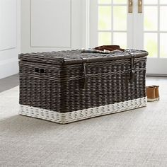 Dipped at the base in white for contrast, this woven rattan trunk has a dark rubbed finish and leather straps. With a roomy divided interior, the coastal casual trunk is perfect for end-of-bed storage. Crate Storage, Bench With Storage, Bed Storage, Storage Baskets, Storage Chest, Dipped Furniture, Painted Furniture, Rattan, Wicker
