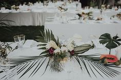 Elegant-Boho Palm Springs Wedding, Centerpieces with Ferns and Tropical Flowers at our very own http://www.casademontevista.com/