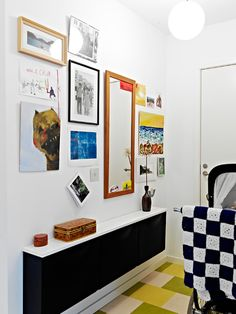 Ikea Trones topped with white shelf make an entry console.  Wall mounted, so you can sweep under it!