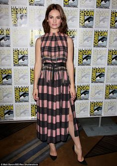 Just right: The 26-year-old looked stunning in a black and pink checkered dress, which clinched in at the waist