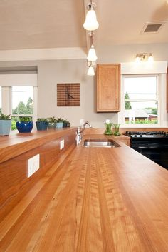 Butcher Block/Wood Countertops for the Kitchen. For some, wood and countertops just don't seem to mix. But a high-quality wood with the right kind of sealer can make for a beautiful, warm and long-lasting countertop. Wooden Countertops, Kitchen Countertop Materials, Kitchen Countertops, Countertop Backsplash, Kitchen Corner, Kitchen And Bath, New Kitchen, Kitchen Ideas, Kitchen Small