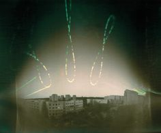 A pinhole camera recorded this time-lapse image over a whole year, showing how the path of the sun across the sky traces a shape called an analemma