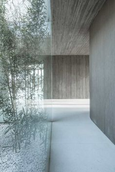 Located in Tangshan, Hebei, China, Waterside Buddist Shrine by ARCHSTUDIO The design started from the connection between the building and nature, adopts the method of earthing to hide the… - architecture Architecture Design Concept, Detail Architecture, Art Et Architecture, Concrete Architecture, Minimalist Architecture, Minimalist Interior, Patio Interior, Interior And Exterior, Interior Design