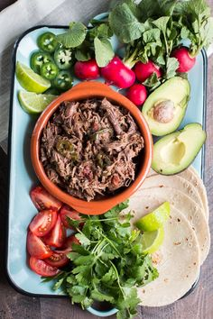 This slow cooker #Mexican shredded #beef* is very versatile. Pile it on burritos, tacos, or even make enchiladas or tamales with it!
