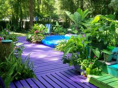 Colorful garden--repurposing wooden pallets by painting them a bright color and making a deck.
