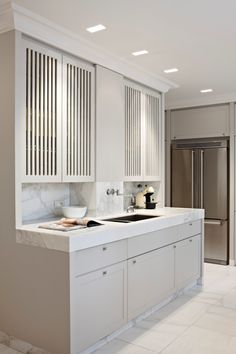 thick marble countertops, louvered doors and inset cabinetry, marble kickplates - iXtra