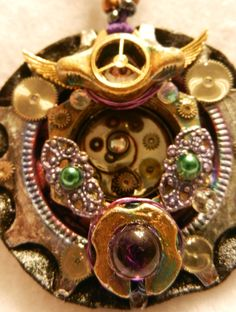 Steampunk Bike Gear Medallion Pendant, Decorative painted punk pink & purple accents, tarnished patina paint varnish, tiny watch & clock parts detailing & filigree , sterling silver & gold tone metallic beads & purple glass beads.