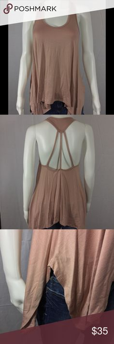 💝HP💝Oversized Sharkbite Tank Adorable shark bite tank top. Dusty Rose in color. 3 spaghetti straps on back. 96% rayon. 4% spandex. Mannequin is wearing a small. Promesa USA Tops Tank Tops