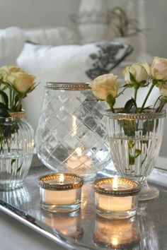 Crystal, roses and candles on the living room end table.