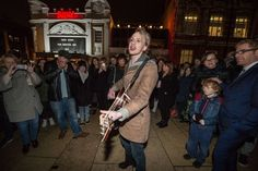 Crowds gather outside the Ritzy cinema in south London to pay homage to British singer David Bowie